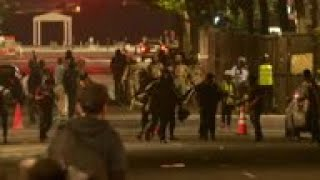 Advancing police scatter Portland protesters