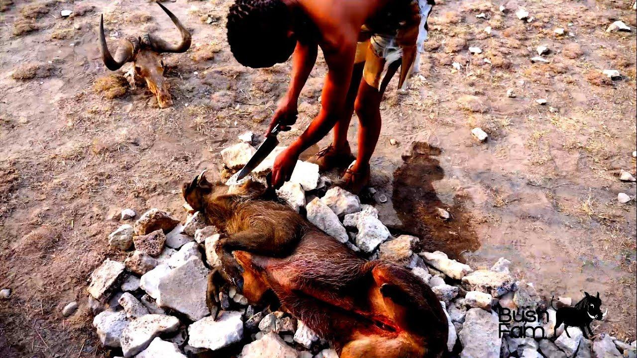 Cooking Warthog Head in Africa - Pumba