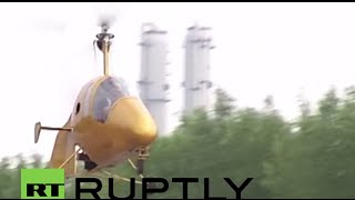 Meanwhile in China: Farmer goes for a spin on a home-made gyrocopter he was building for 7 yrs