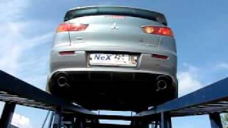 ВИД СНИЗУ. _Mitsubishi Lancer X. Глушитель -Форсаж- + накладка Zodiac