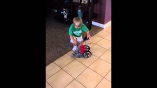 Hilarious Video Of Toddler Trying To Get Into An American Girl Wheelchair