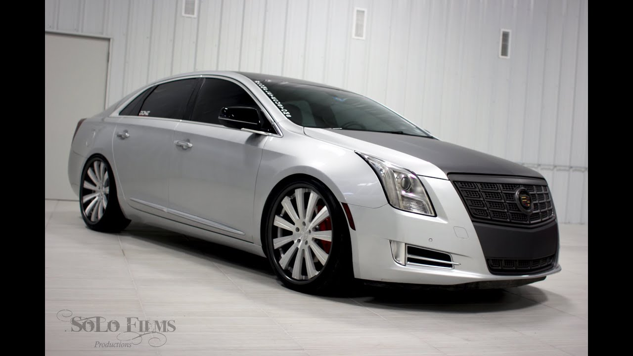 four media images grill on com xts and r chrome lexani rendered cadillac