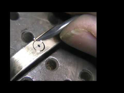 Engraving a cartier style screw gold bangle,with the homemade hand engraving machine.