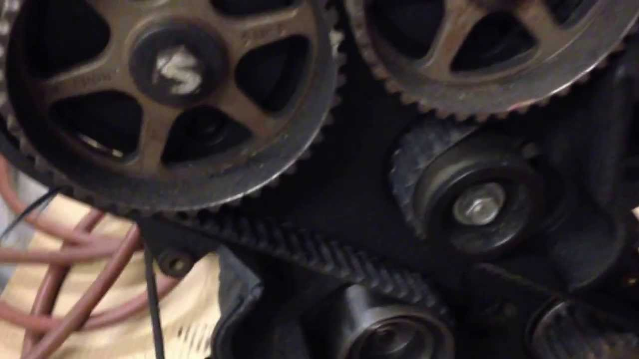 2.4 Dodge Stratus engine timing belt walked, sliced through timing cover - YouTube