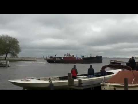 Barge turning crowded space + wind