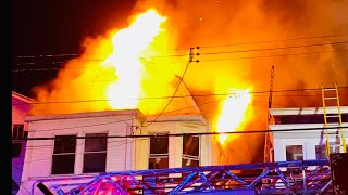 JERSEY CITY FIRE DEPARTMENT BATTLING A 3RD ALARM FIRE IN 2 PRIVATE DWELLINGS ON NEPTUNE AVENUE, JC.