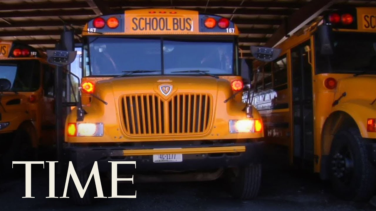 crash between school bus and dump truck kills one adult and one