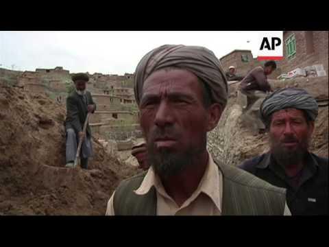 Rescuers struggle to help Afghans hit by massive landslide