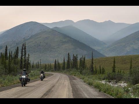 Traveling to Tuktoyaktuk on the Arctic Ocean by adventure motorcycle