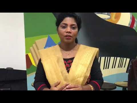 Singer Minmini talking about a program