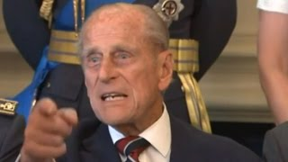 Prince Philip swears at photographer