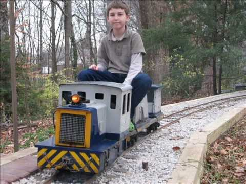 Live steam garden railway backyard GE 25 diesel switcher railroad construction  train rides