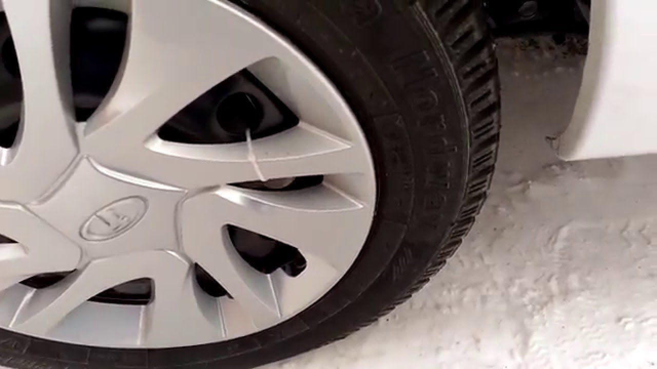Хромированные колпаки на колёса на Lada Granta Autoprofi R 14 .