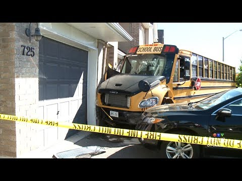 School bus with children on board crashes into Ottawa home