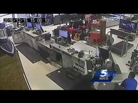 Caught on camera: Men armed with gun, hammer hit metro pawn shop