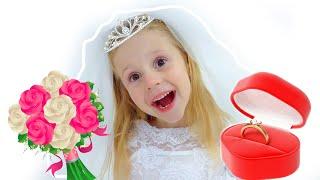Nastya devient une mariée dans une belle robe de mariée