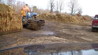 Unloading Wet Moss on Hard Ground with Oliver OC-6 and CAT 416