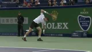 Andy Murray smashing his racket