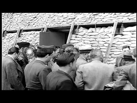United States publishers and editors visit a prisoner of war enclosure and a cath...HD Stock Footage