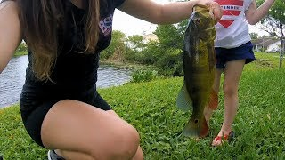 Girl Fishing and Catching Peacock Bass and Largemouth Bass in South Florida