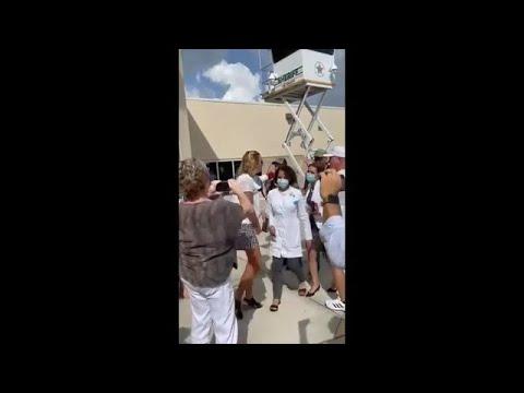 New video shows tense encounter between doctors & protestors outside Lee Schools HQ