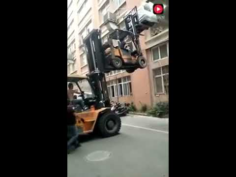 Double forklift load into second floor window fails miserably!