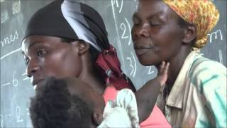 Pan shot from hand to African mother with child