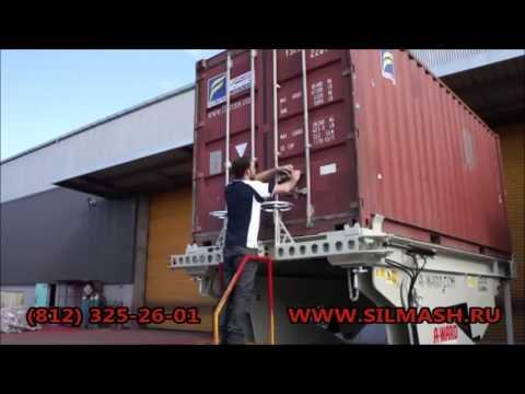 Погрузка оборудования на базе контейнера в тентованную еврофуру .