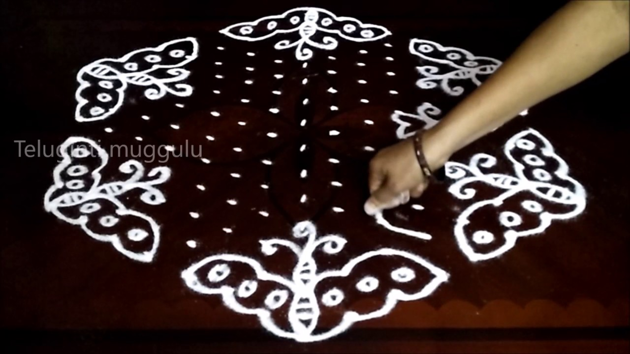 Simple butterfly kolam designs with15 8 middle chukkala for Dots design apartment 8