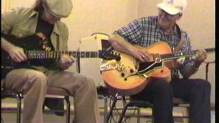 "Bob Saxton and John Richards jam at CAAS 1999, on ""Cannonball Rag""."