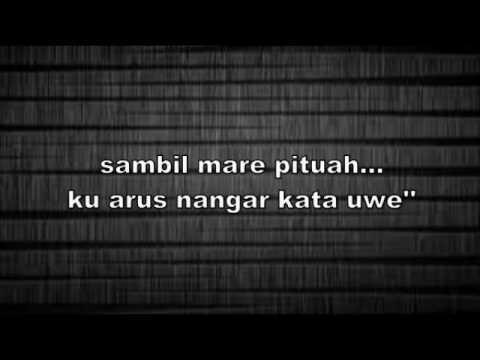 Jacky Putirulan BAJONGGAN MAN APA' ofical lirik by mario rinyuakng
