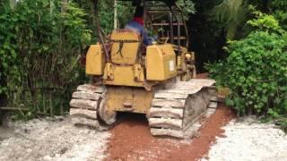 Bulldozing red laterite in small village roadបុលឈួសដីក្រហមធ្វើផ្លូវតូចៗតាមភូមិ
