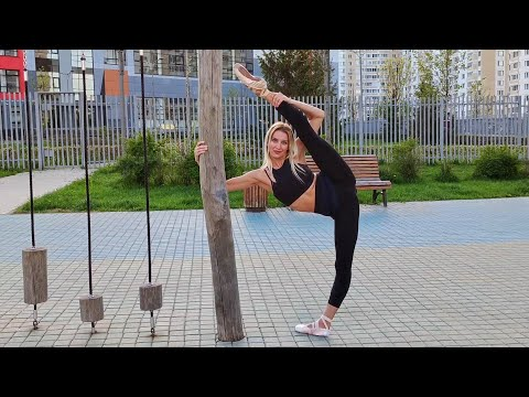 Ballerina Stretching In Pointe Shoes. Outdoor Training.