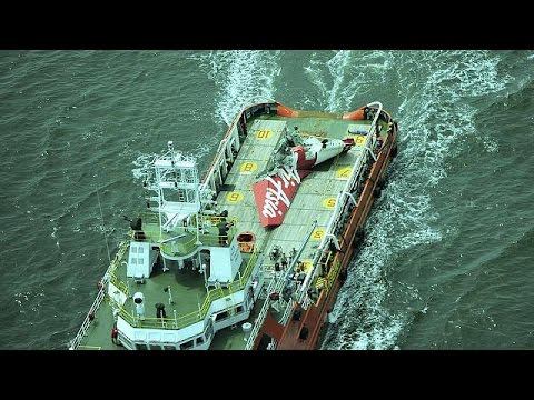 Indonesia search teams home in on AirAsia fuselage
