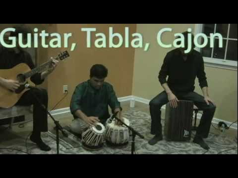Guitar, Cajon, and Tabla Piece at Taalim School