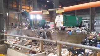 Garbage Trucks and Street Cleaner unload at Tip for Bull Dozer