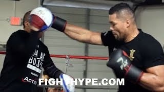 JOE JOYCE SMASHES PADS WITH THUDDING PUNCHES; MAKES TRAINER GRIMACE FROM POWER