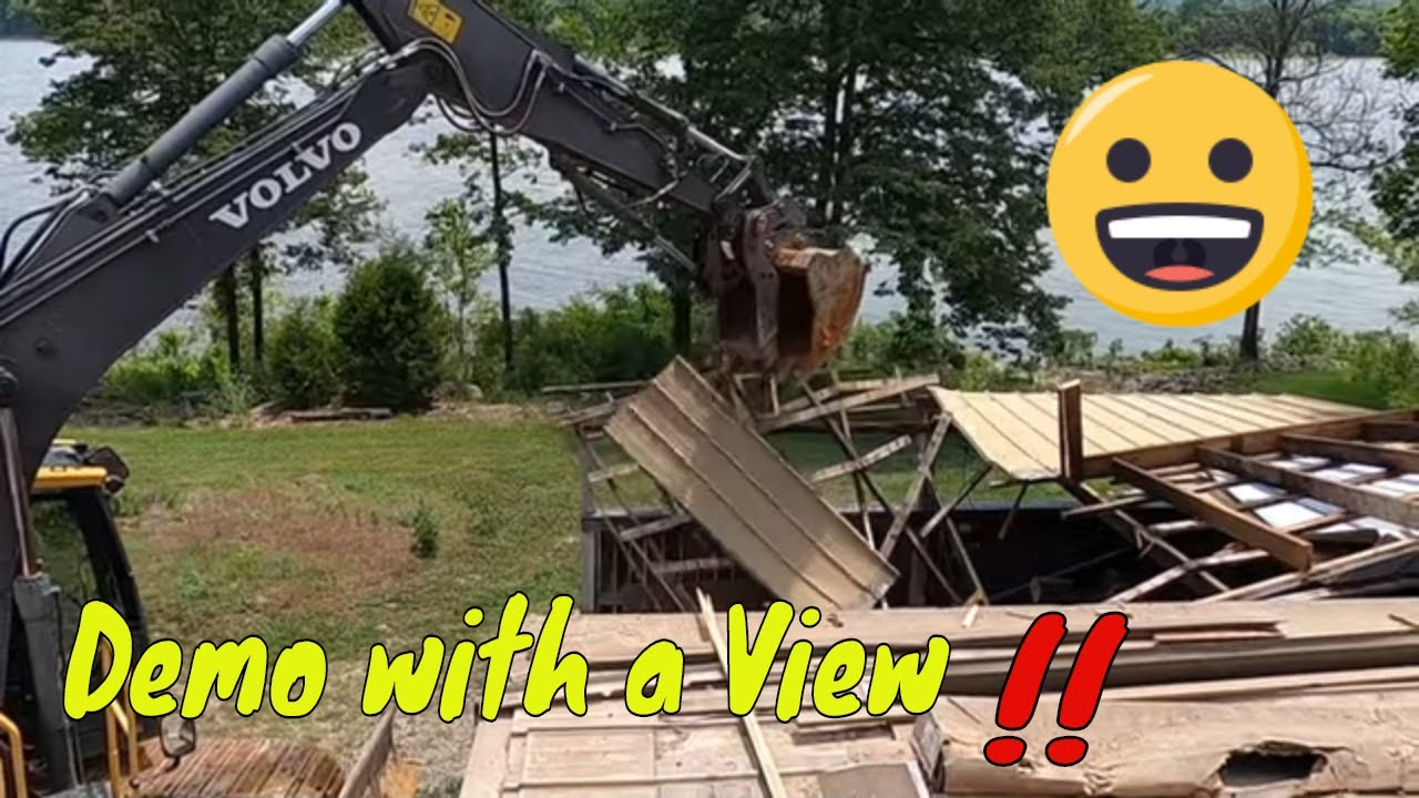 Demoing a small building with Volvo excavator in preparation for a new retaining wall build,