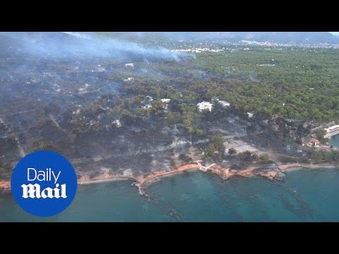 Helicopter footage shows devastation caused by Greek wildfires - Daily Mail