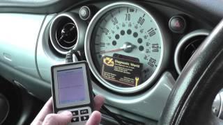 2006 mini cooper brake pad warning light reset