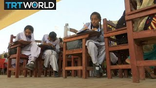 International Day of the Girl: Karachi classroom hits streets to help kids