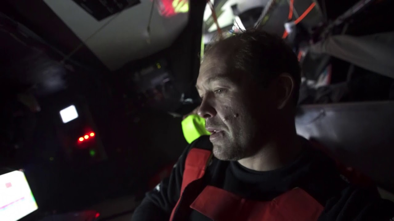 Kevin, below: Not the best night on Dongfeng. We've been quite slow. We don't know why. It's been quite windy. 65-80 wind angle. Lot of wind; 30-40 knots. 2 reefs and J2. Slow; hard to know why. Very annoying. We're behind MAPFRE, and Brunel passed us, Turn the Tide, and AkzoNobel. We are now back ahead of Turn the Tide. But still a lot of work involved to come back at least on Brunel and MAPFRE to be able to play something on the next leg for the final victory. Crew in the cockpit. Other boat to leeward (TTToP?).
