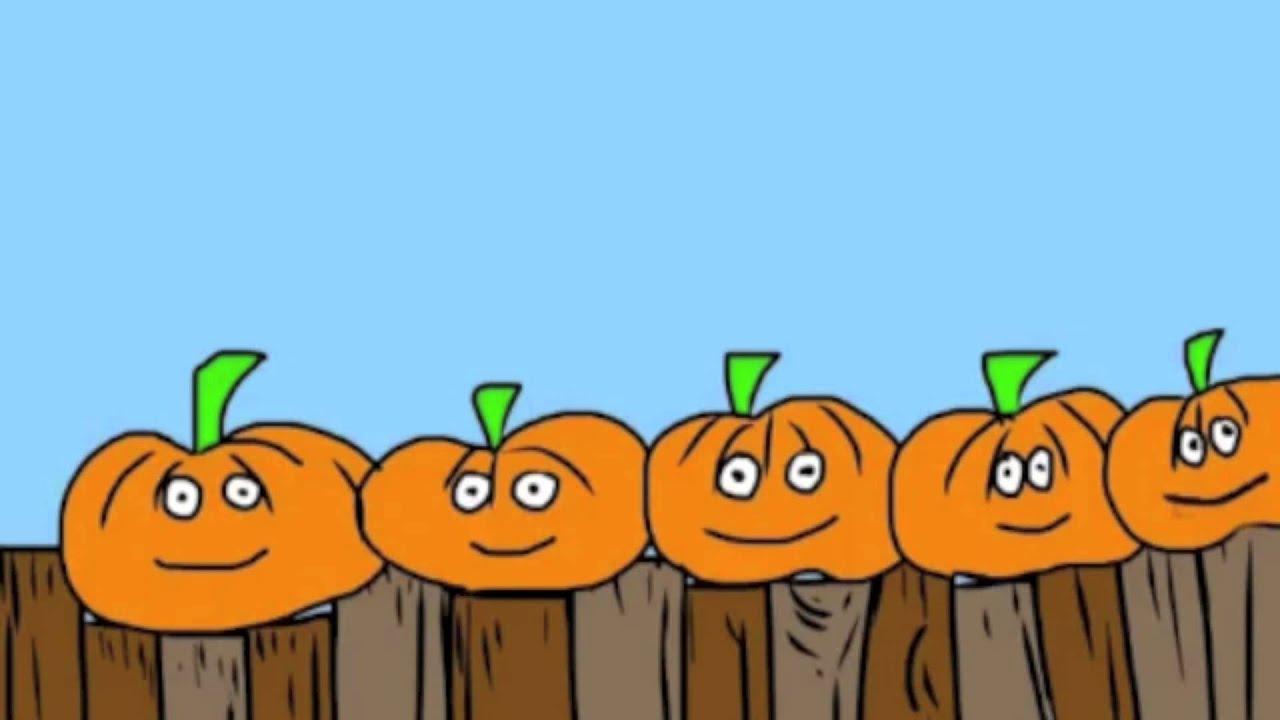 5 little pumpkins sitting on a gate - YouTube