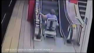 Stupid Woman Rides A Mobility Scooter Up An Escalator