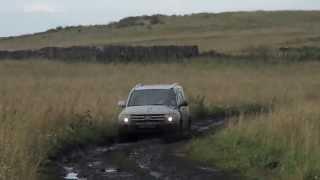 Mitsubishi Pajero 4 on a field road