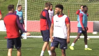 Oxlade-chamberlain all smiles in england training