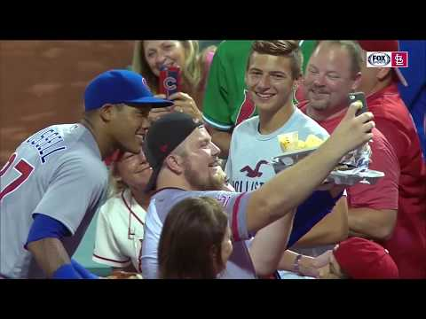Addison Russell knocks over Cardinals fan