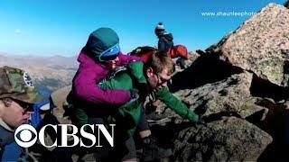 Woman in wheelchair climbs 14,000 foot mountain