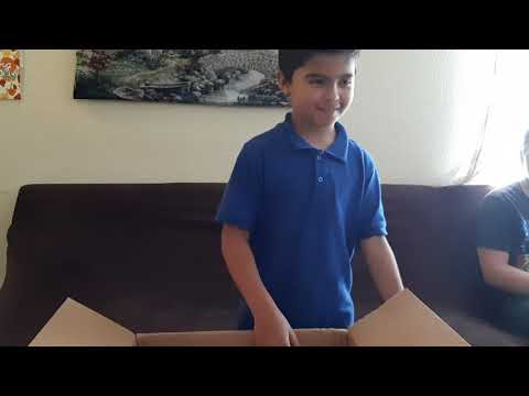 Nathaniel opens his 4th grade supplies from River Springs Charter School.