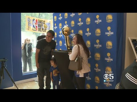 Warriors Fans Line Up To Take Photo With NBA Championship Trophy